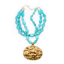 Колье - бусы с большим золотым медальоном
